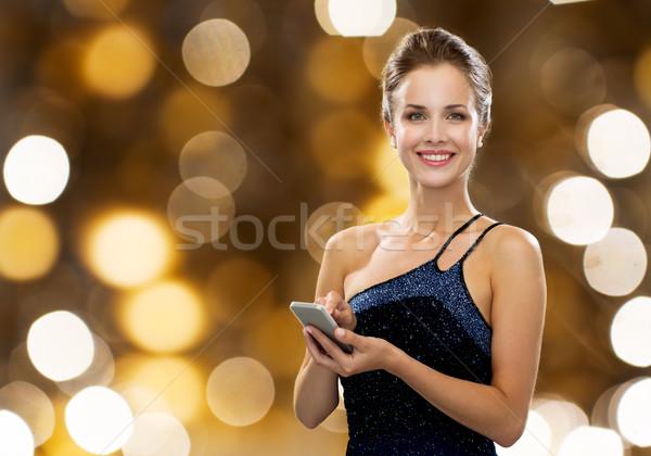 Sorrindo vestido de noite tecnologia comunicação pessoas Foto stock © dolgachov