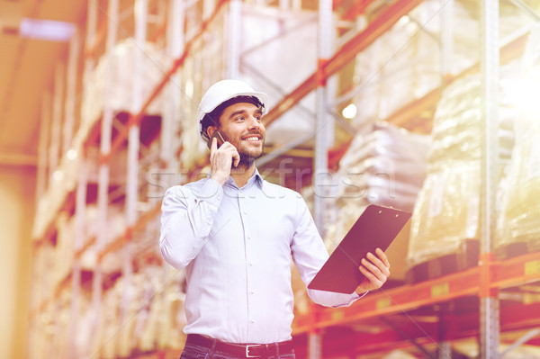 Man smartphone magazijn groothandel business Stockfoto © dolgachov