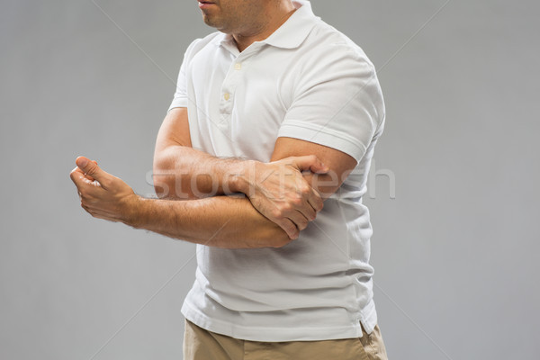 close up of man suffering from pain in hand Stock photo © dolgachov