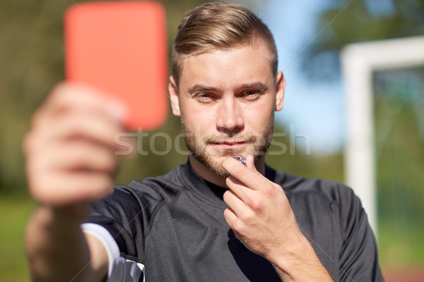 referee on football field showing red card Stock photo © dolgachov