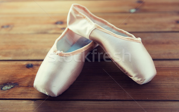 Stock photo: close up of pointe shoes on wooden floor