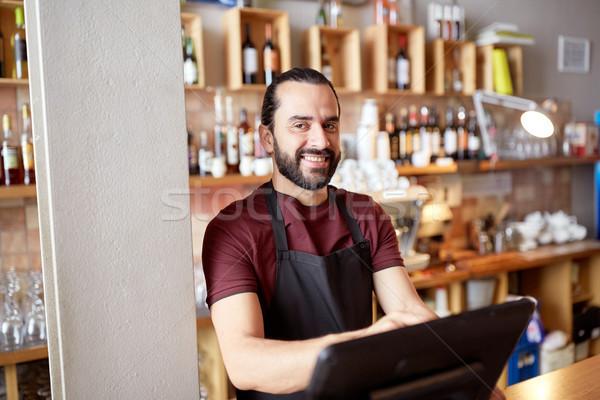 happy man or waiter at bar cashbox Stock photo © dolgachov