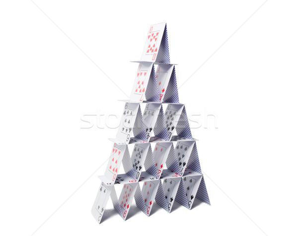 house of playing cards over white background Stock photo © dolgachov