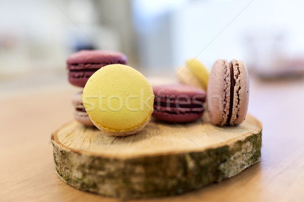 different macarons on wooden stand Stock photo © dolgachov