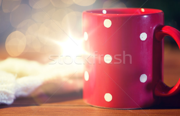 red polka dot tea cup on wooden table Stock photo © dolgachov