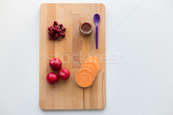 fruit puree or baby food in jar and feeding spoon Stock photo © dolgachov