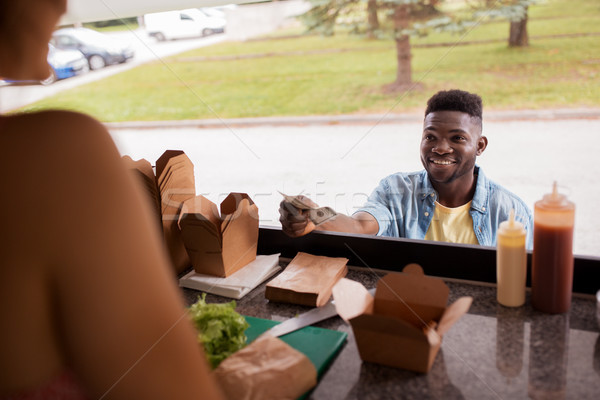 african american man buying wok at food truck Stock photo © dolgachov