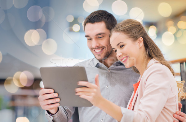 happy couple with tablet pc taking selfie in mall Stock photo © dolgachov