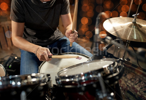 Stock photo: male musician playing drum kit at concert