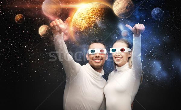 Couple lunettes 3d regarder espace projection technologie Photo stock © dolgachov