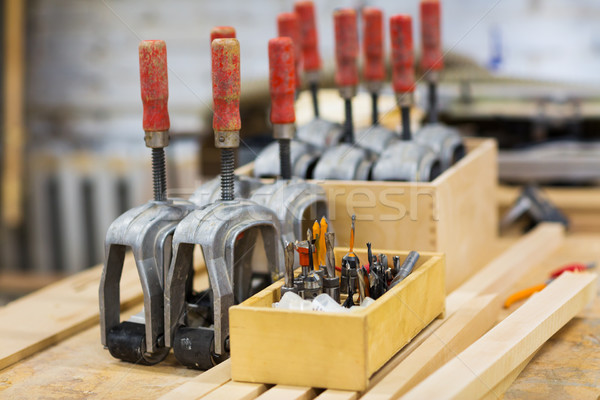 drills and woodworking tools at workshop Stock photo © dolgachov