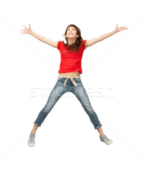 Jumping luminoso foto felice donna Foto d'archivio © dolgachov
