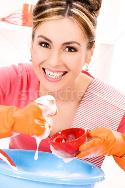 housewife washing dish Stock photo © dolgachov