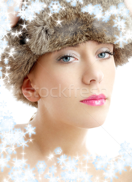 lovely beauty in winter hat with snowflakes Stock photo © dolgachov