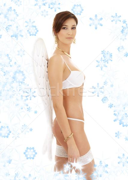 Brunetka biały bielizna płatki śniegu ciało Zdjęcia stock © dolgachov