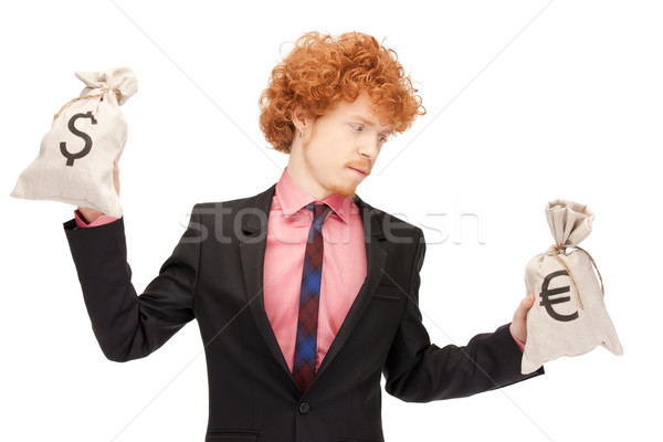 man with euro and dollar bags Stock photo © dolgachov
