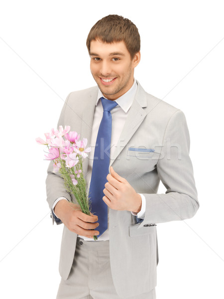 Hombre guapo flores mano Foto hombre feliz Foto stock © dolgachov