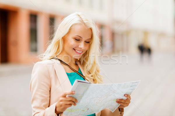 girl looking into tourist map in the city Stock photo © dolgachov