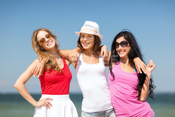 group of girls chilling on the beach Stock photo © dolgachov