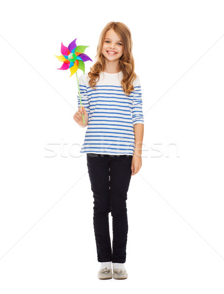 child with colorful windmill toy Stock photo © dolgachov