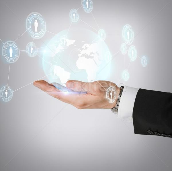 Kéz tart hologram földgömb üzlet technológia Stock fotó © dolgachov