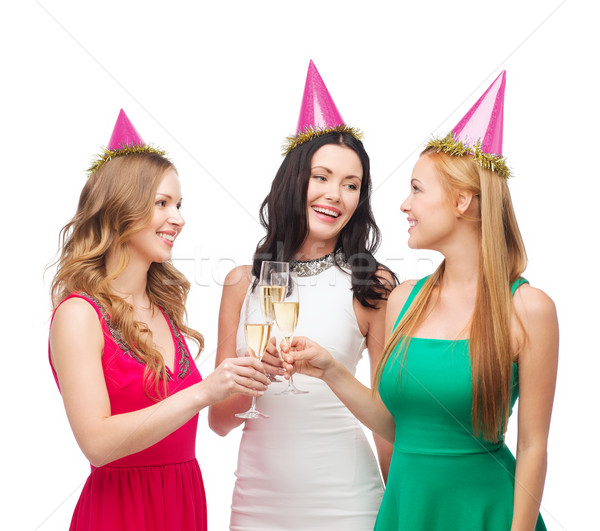 three women in pink hats with champagne glasses Stock photo © dolgachov