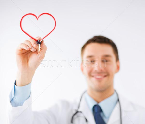 Férfi orvos rajz szív levegő gyógyszer egészség Stock fotó © dolgachov