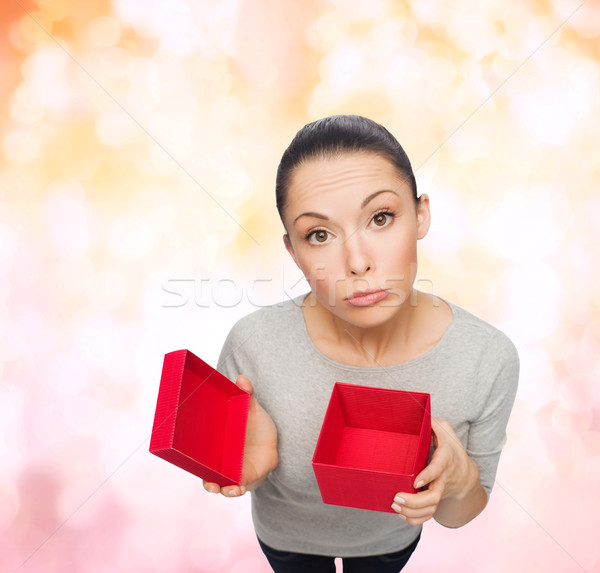 disappointed asian woman with empty red gift box Stock photo © dolgachov