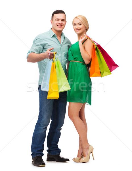 Mosolyog pár bevásárlótáskák boldogság vásárlás nő Stock fotó © dolgachov