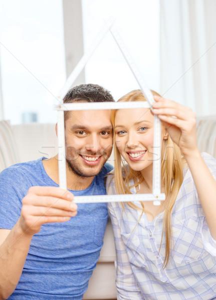 Uśmiechnięty para domu ruchu domu Zdjęcia stock © dolgachov