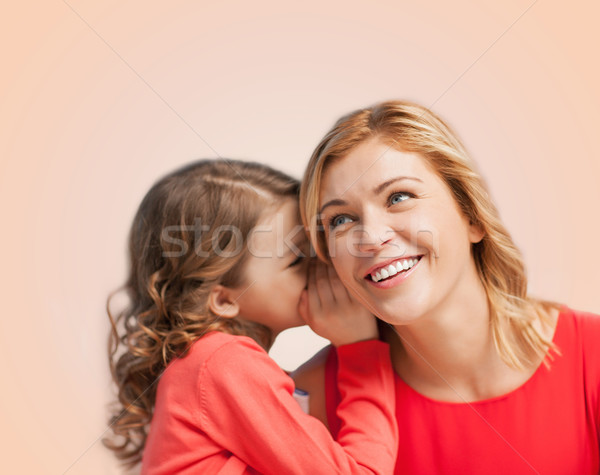 smiling mother and daughter whispering gossip Stock photo © dolgachov