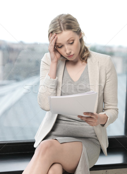 worried woman with documents Stock photo © dolgachov