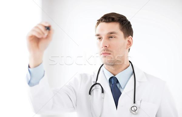 Jeunes médecin travail quelque chose imaginaire santé Photo stock © dolgachov