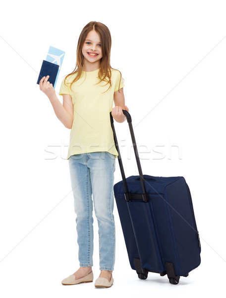 Stock photo: smiling girl with suitcase, ticket and passport