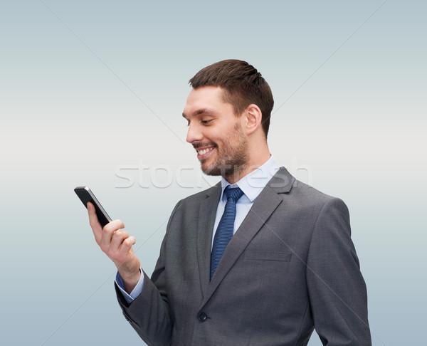 Giovani sorridere imprenditore smartphone business tecnologia Foto d'archivio © dolgachov