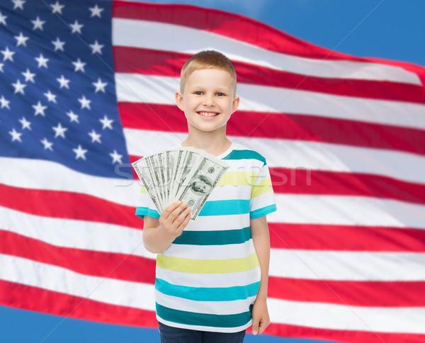 улыбаясь мальчика доллара наличных деньги Сток-фото © dolgachov