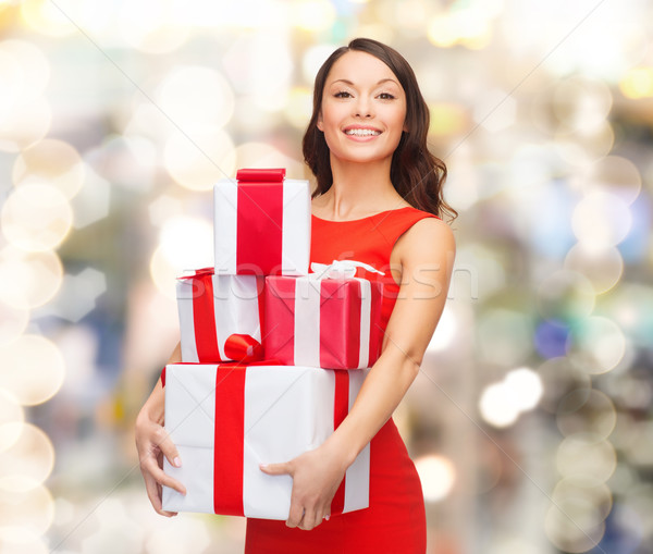 улыбающаяся женщина красное платье шкатулке Рождества праздников Сток-фото © dolgachov