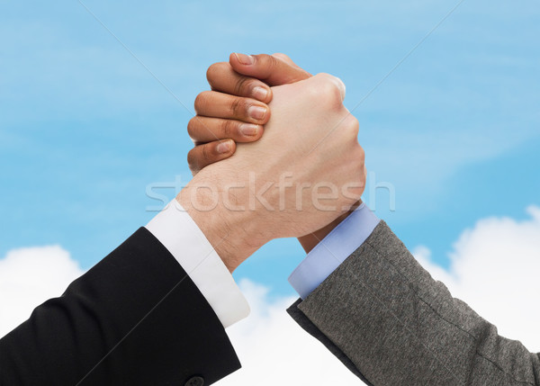 close up of hands arm wrestling over concrete wall Stock photo © dolgachov