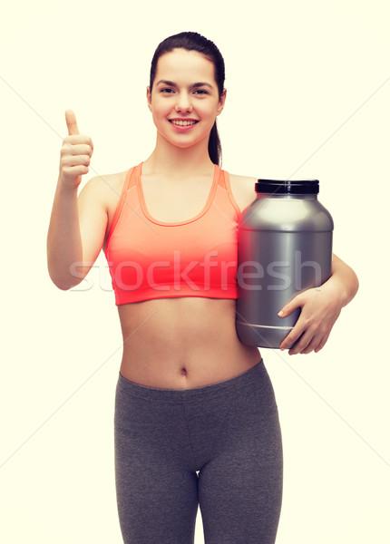Stok fotoğraf: Genç · kız · kavanoz · protein · uygunluk