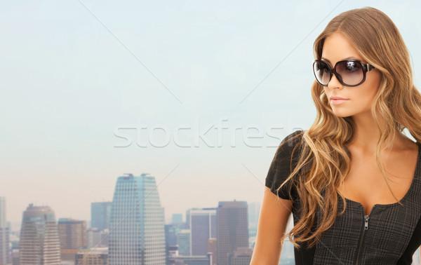 beautiful young woman in shades Stock photo © dolgachov