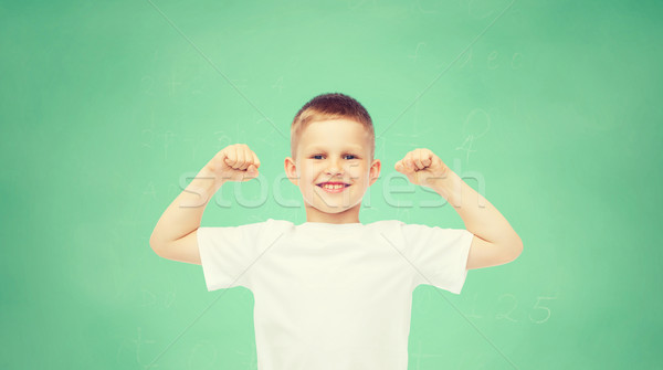 Gelukkig weinig jongen witte tshirt biceps Stockfoto © dolgachov