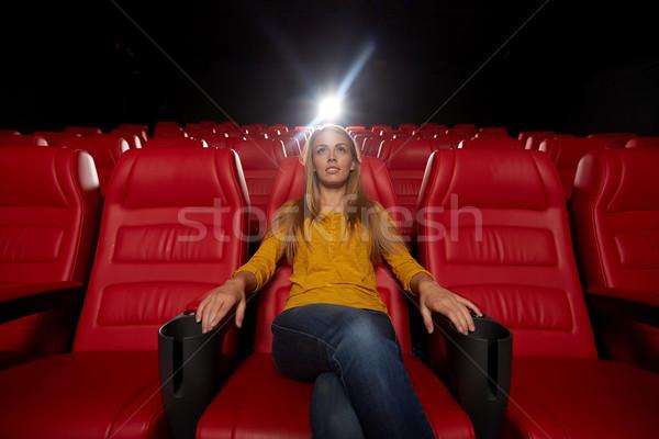Fiatal nő néz film színház mozi szórakoztatás Stock fotó © dolgachov