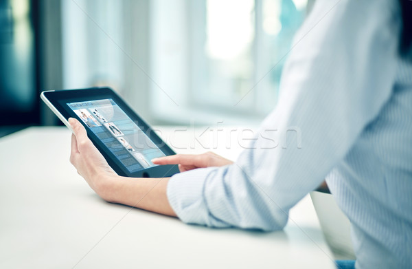 close up of woman hands with tablet pc at office Stock photo © dolgachov