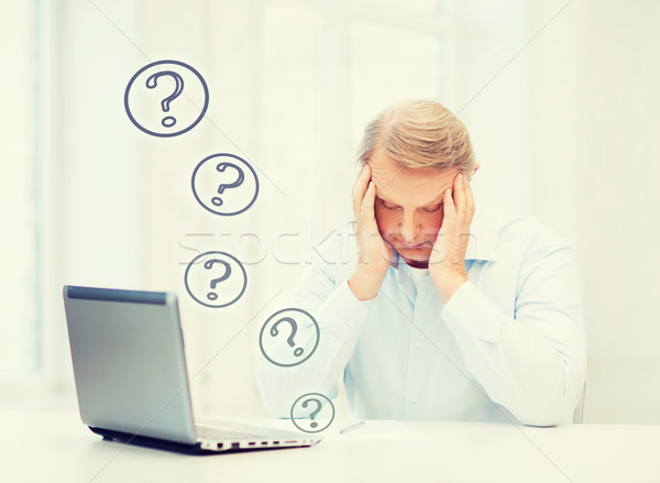 stressed old man filling a form at home Stock photo © dolgachov
