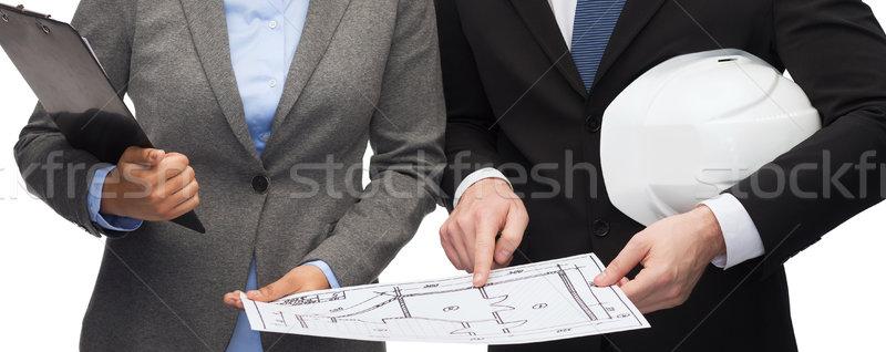 businesspeople with blueprint and helmet Stock photo © dolgachov