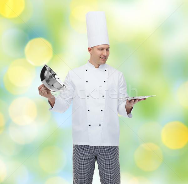 Mutlu erkek şef pişirmek açılış pişirme Stok fotoğraf © dolgachov
