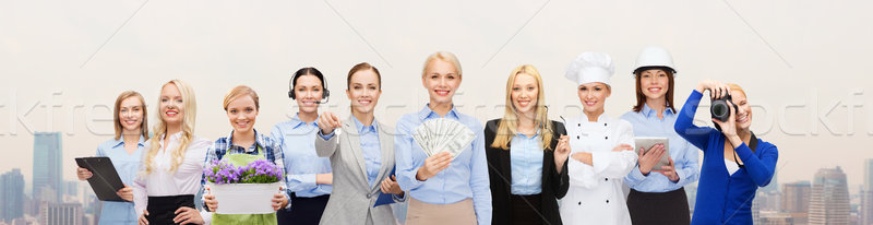 woman holding money over professional workers Stock photo © dolgachov