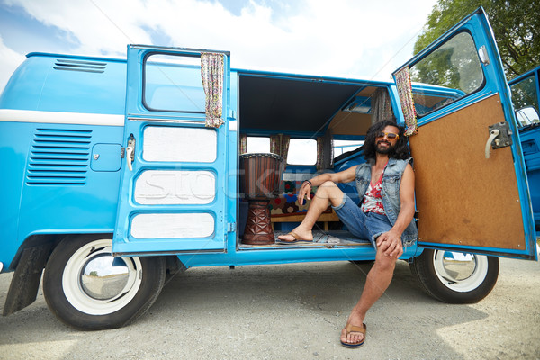 smiling young hippie man in minivan car Stock photo © dolgachov