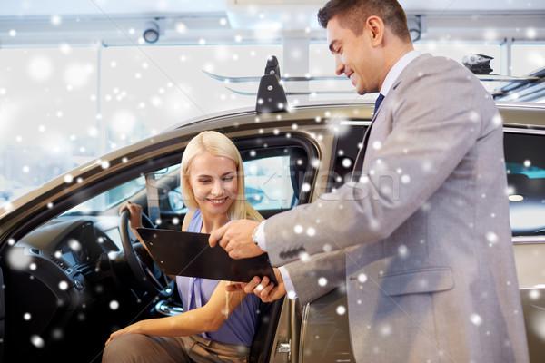 Mutlu kadın araba satıcısı oto göstermek salon Stok fotoğraf © dolgachov