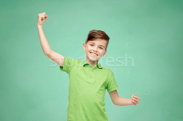 happy school boy in t-shirt showing strong fists Stock photo © dolgachov